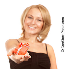 Cheerful female with Christmas gift