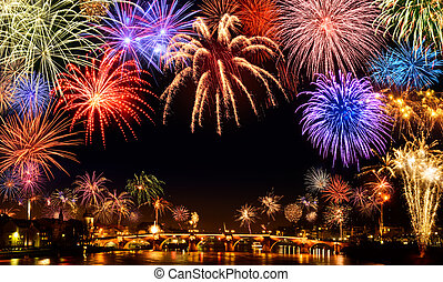 Cheerful fireworks display in the city, with lots of...
