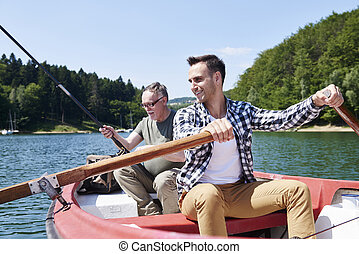 Cheerful fishermen on camping trip