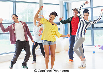 Cheerful fitness class and instruct