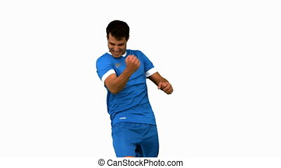 Cheerful football player gesturing