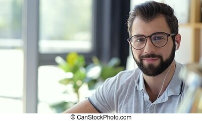 Cheerful freelancer in glasses smiling for camera