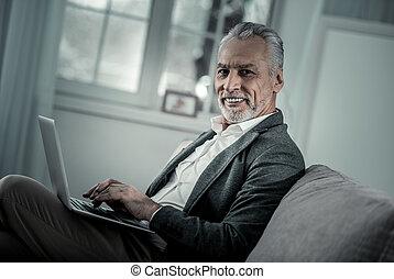 Cheerful freelancer looking straight at camera