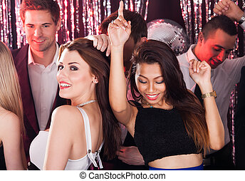 Cheerful Friends Dancing In Nightclub - Portrait of cheerful...