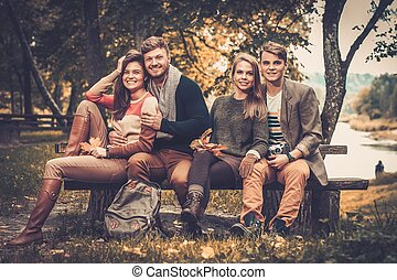 Cheerful friends in autumn park