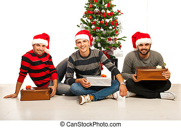 Cheerful friends with Christmas gifts
