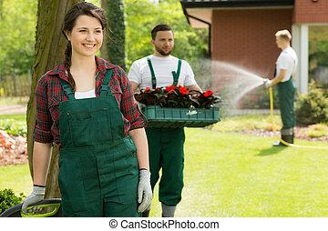 Cheerful gardener enjoying work in garden