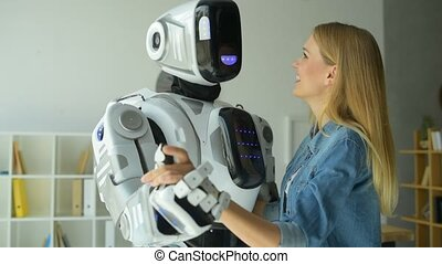 Cheerful girl dancing with robotic machine
