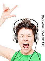 cheerful girl enjoying a white background music on headphones isolated