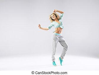 Cheerful girl exercising with music - Cheerful girl...
