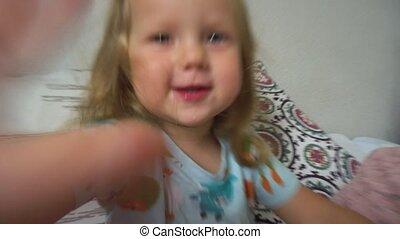 Cheerful girl having fun on bed - Adorable little girl...