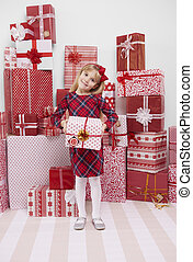 Cheerful girl holding red present