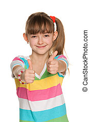 Cheerful girl holds her thumbs up