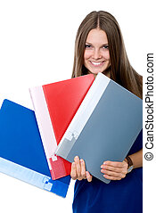 Cheerful girl in a blue dress with folders for documents