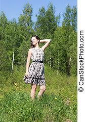 Cheerful girl in dress