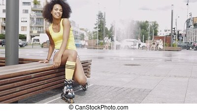 Cheerful girl in rollers - Young beautiful woman in summer...