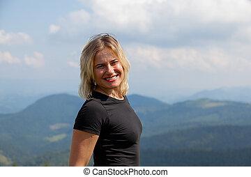 cheerful girl in the carpathians