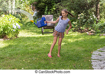 cheerful girl in the summer garden