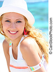 Cheerful girl in vacation at the beach