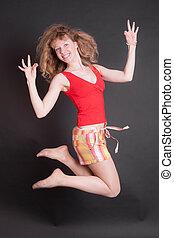 cheerful girl jumping