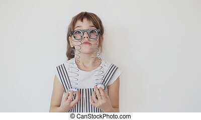 Cheerful Girl make a Faces in Droopy Eye Glasses - Cheerful...