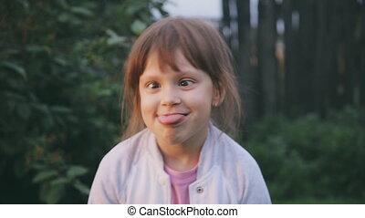 Cheerful Girl make a Faces