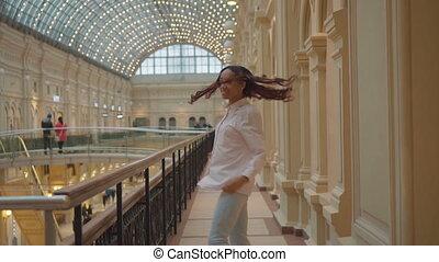 Cheerful girl mulatto woman in a shopping center