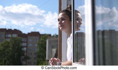 Cheerful girl on the balcony. slow motion - Cheerful girl on...