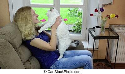 cheerful girl play cat