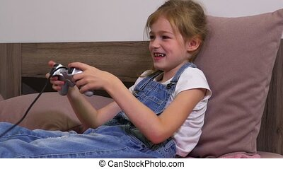 Cheerful girl plays computer game