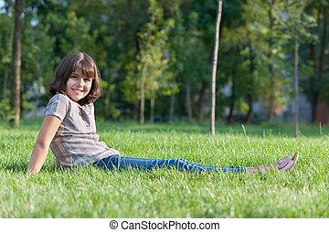 Cheerful girl resting in the park