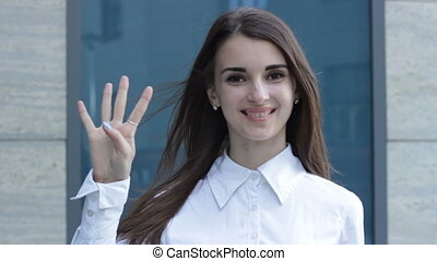 cheerful girl showing gesture four and smiling