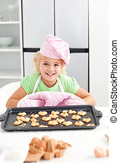 Cheerful girl showing her cookies
