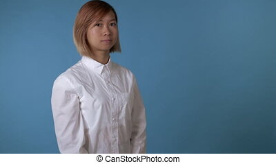 cheerful girl shows positive emotions - portrait young asian...