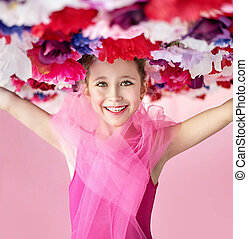 Cheerful girl with a flower hat