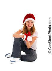 cheerful girl with Christmas presen