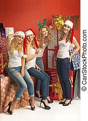 Cheerful girlfriends among huge presents