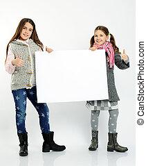 cheerful girls holding blank board