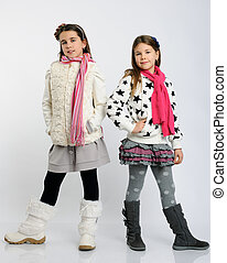 cheerful girls in a winter clothes