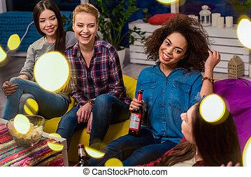 Cheerful girls speaking in apartment