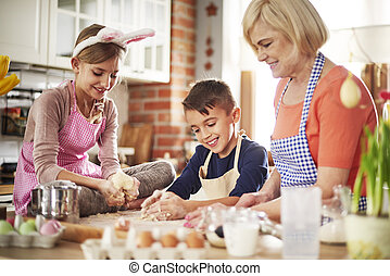 Cheerful grandmother with two little helpers