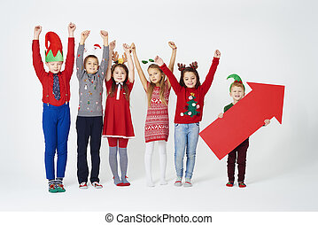 Cheerful group of children in christmas costume