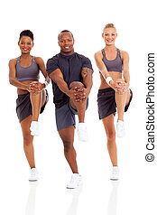 group of people stretching before working out