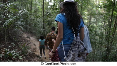 Cheerful Group Of Tourists Trekking Forest Path On Hike,...
