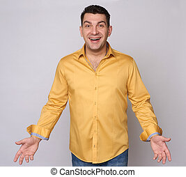 Cheerful guy in yellow shirt isolated