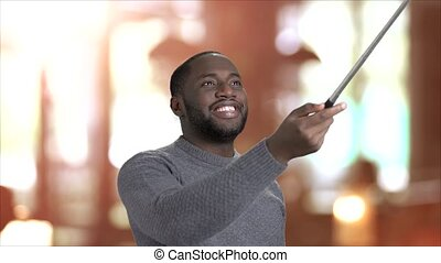 Cheerful guy using selfie stick. Happy smiling afro-american...