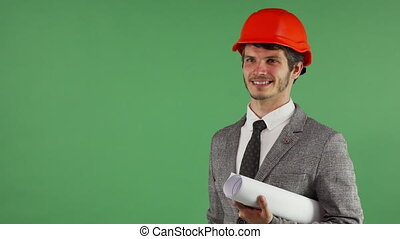 Cheerful handsome engineer holding copy space on his hand