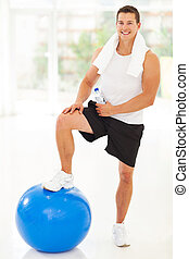 young fitness man in gym