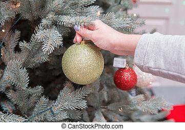 Cheerful happy customer girl choosing Christmas tree...