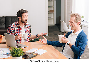 Cheerful happy men enjoying tea